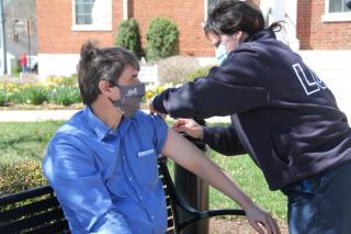 Mayor Ramsey receiving his COVID-19 vaccination.